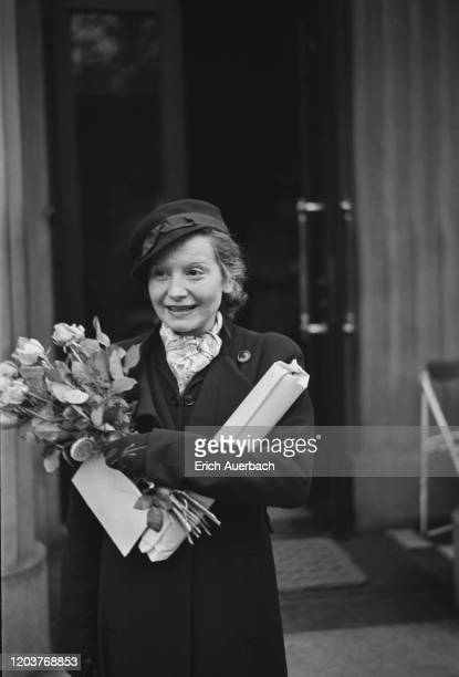 Austrian-British actress Elisabeth Bergner holding a bouquet of roses, circa 1935.