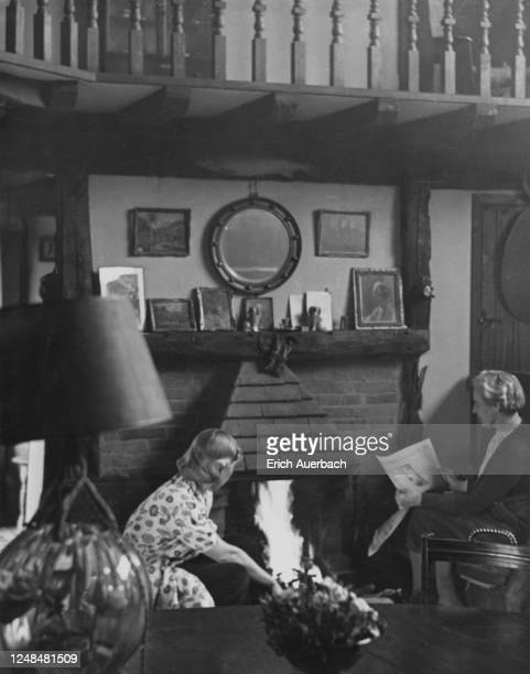 Austrian-Czechoslovak artist Mary Duras sits near a fireplace with painter Augusta North at her residence, Buckinghamshire, UK, 1942.