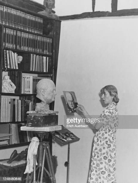 Austrian-Czechoslovak artist Mary Duras working on a bust of Winston Churchill in her studio, Buckinghamshire, UK, 1942.