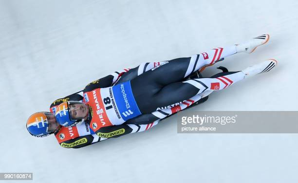 Austrians Thomas Streu and Lorenz Koller compete in the Luge World Cup men's doubles at Koenigssee, Germany, 6 January 2018. Photo: Tobias Hase/dpa