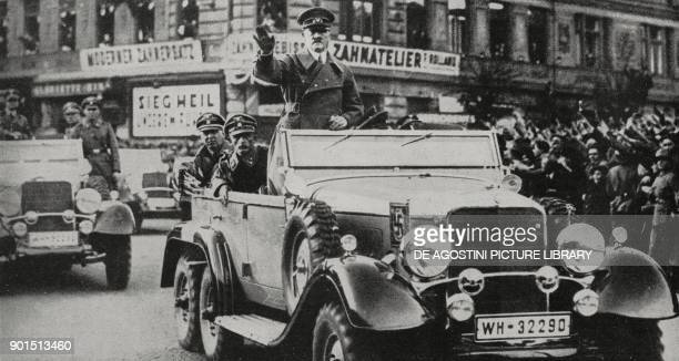 Austrians welcoming Adolf Hitler's arrival into Vienna Anschluss Austria from L'Illustrazione Italiana Year LXV No 12 March 20 1938