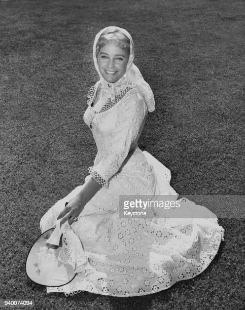 AustrianSwiss actress Maria Schell wearing an eyelet embroidered white cotton dress USA circa 1958