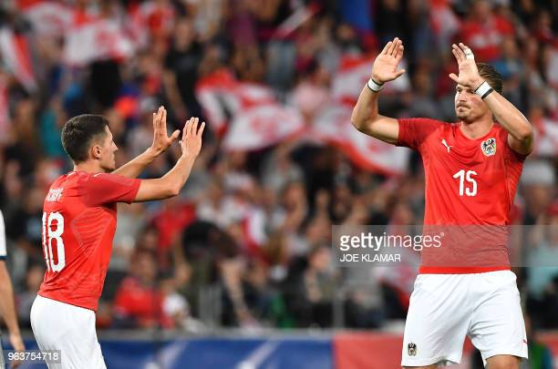 Austria's Alessandro Schoepf celebrates his goal with Sebastian Proedl during their international friendly football match between Austria and Russia...