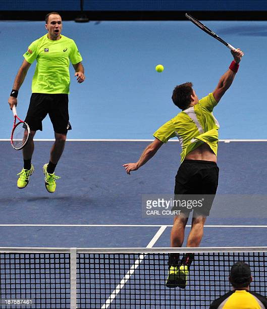Austria's Alexander Peya returns at the net as his partner Brazil's Bruno Soares looks on against US player Bob Bryan and his partner US player Mike...