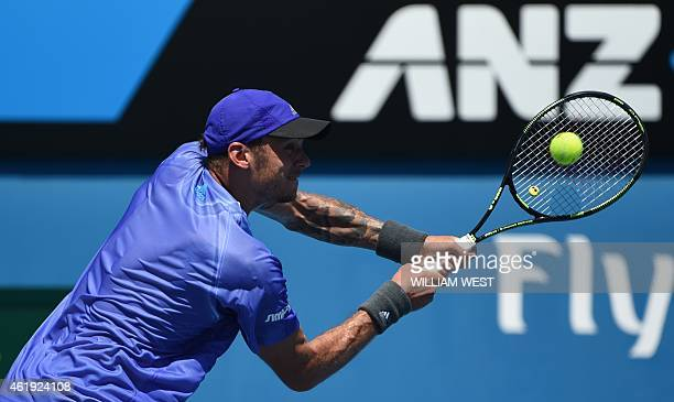 Austria's Andreas HaiderMaurer plays a shot during his men's singles match against John Isner of the US on day four of the 2015 Australian Open...