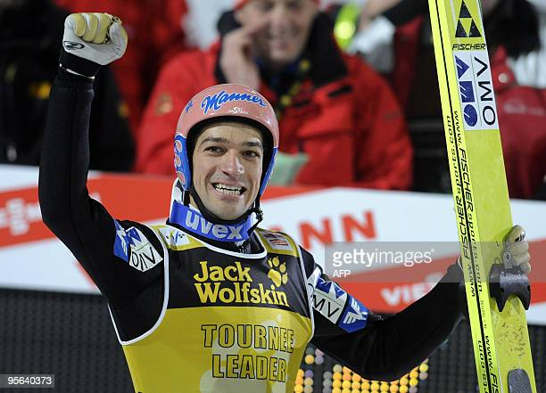 Austria's Andreas Kofler celebrates in the finish area his victory in the Four Hills FIS ski jumping championship in Bischofshofen on January 6 2010...