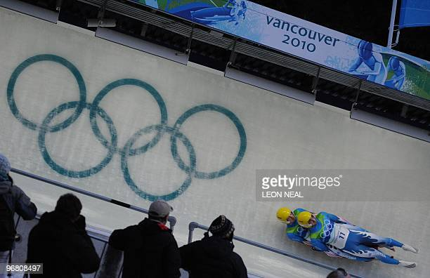 Austria's Andreas Linger and Wolfgang Linger compete in the men's Luge doubles at the Whistler Sliding Centre during the Vancouver Winter Olympics on...