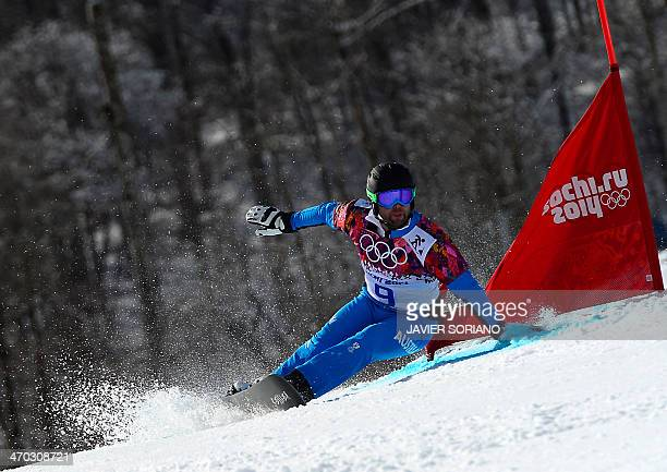 Austria's Andreas Prommegger competes in the Men's Snowboard Parallel Giant Slalom 1/8 Finals at the Rosa Khutor Extreme Park during the Sochi Winter...