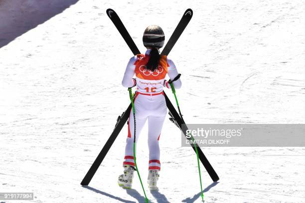Austria's Anna Fenninger Veith celebrates after crossing the finish line of the Women's SuperG at the Jeongseon Alpine Center during the Pyeongchang...