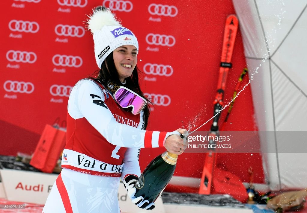 Austria's Anna Veith sprays champagne as she celebrates after winning the women's Super-G race at the FIS Alpine Skiing World Cup in Val-d'Isere, French Alps, on December 17, 2017. /