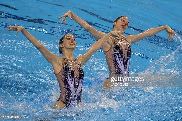 Austria's AnnaMaria Alexandri and EiriniMarina Alexandri perform in the synchronized swimming duet free routine final event at the 2015 European...