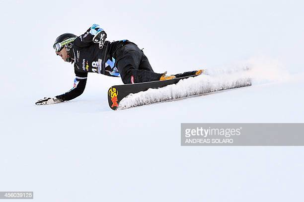 Austria's Anton Unterkofler celebrates as he wins the men's Parallel Giant Slalom event of the FIS Snowboard World Cup in Carezza Dolomites on...