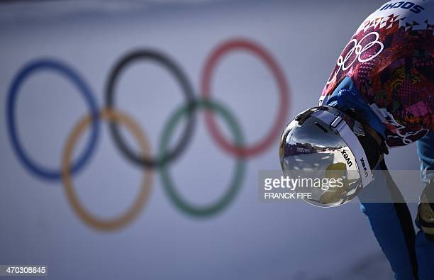 Austria's Benjamin Karl reacts after competing in the Men's Snowboard Parallel Giant Slalom 1/8 Finals at the Rosa Khutor Extreme Park during the...
