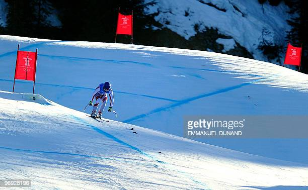 Austria's Benjamin Raich skis during the men's supercombined downhill race of the Vancouver 2010 Winter Olympics at the Whistler Creek side Alpine...