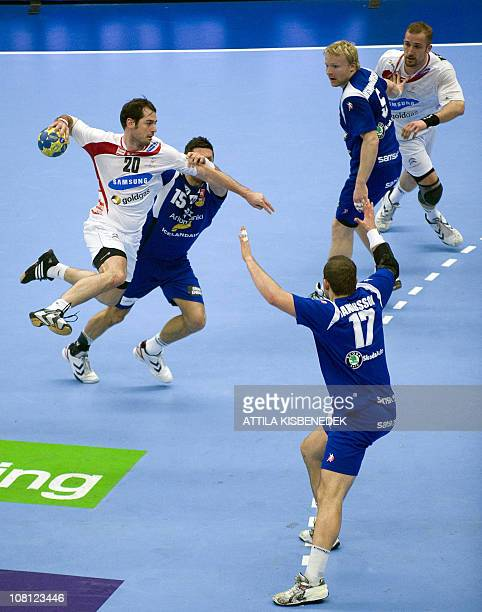 Austria's Bernd Friede is pushed by Iceland's Alexander Petersson during the 22nd Men's Handball World Championships fourth round group B match on...