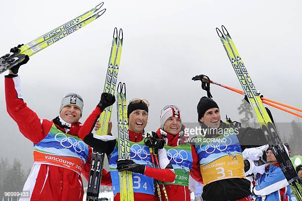 Austria's Bernhard Gruber and teammates Mario Stecher David Kreiner and Felix Gottwald react after the men's Nordic Combined team 4x5 km at the...