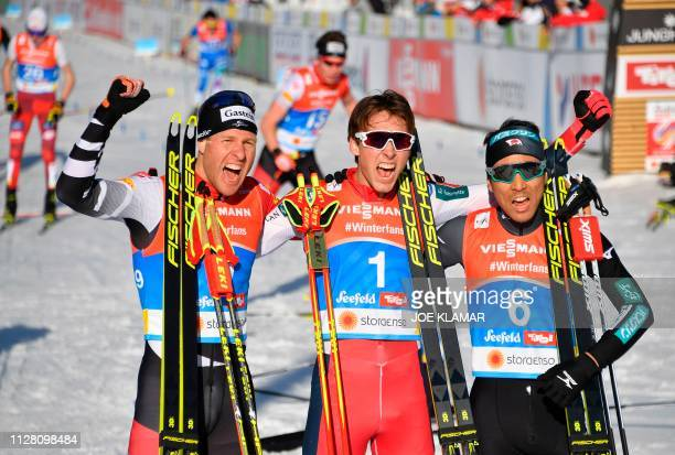 Austria's Bernhard Gruber , Norway's Jarl Magnus Riiber and Japan's Akito Watabe celebrate after the cross-country competition of the men's Nordic...