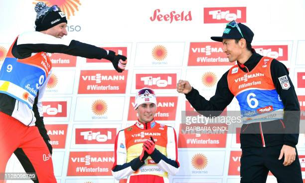 Austria's Bernhard Gruber , Norway's Jarl Magnus Riiber and Japan's Akito Watabe celebrate during the flower ceremony after the cross-country...