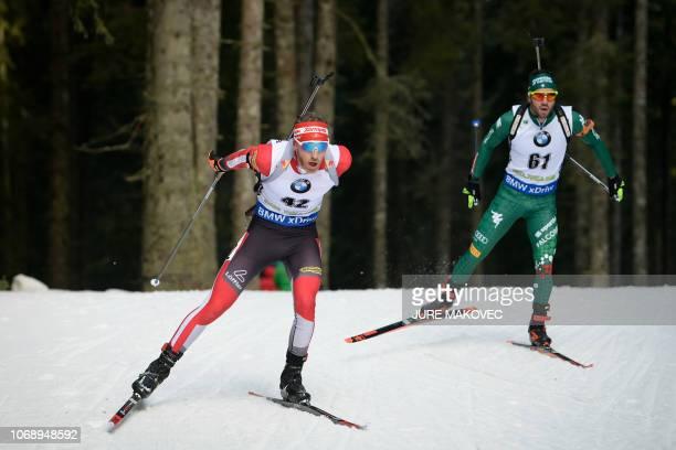 Austria's biathlete Simon Eder competes followed by Italy's biathlete Giuseppe Montello during the IBU Biathlon World Cup Men's 20km Individual...