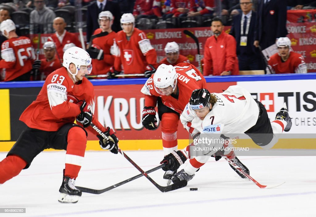 Austria's Brian Lebler (R) vies with Switzerland's Simon Moser (C) and Switzerland's Joel Vermin during the group A match Switzerland vs Austria of the 2018 IIHF Ice Hockey World Championship at the Royal Arena in Copenhagen, Denmark, on May 5, 2018.