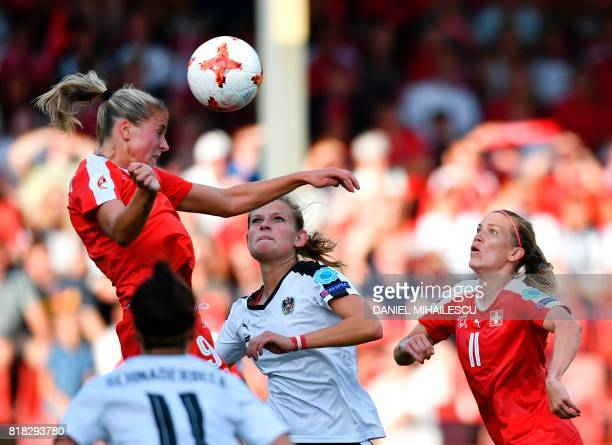 Austria's Carina Wenninger heads the ball next to Switzerland's Ana Maria Crnogorcevic and Lara Dickenmann during the UEFA Womens Euro 2017 football...