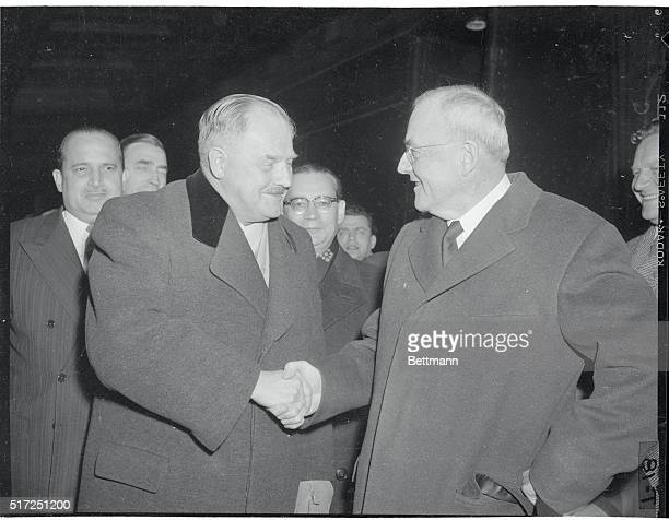 Austria's Chancellor Julius Raab is greeted by U.S. State Secretary John Foster Dulles upon his arrival in Washington, November 21st. Raab is on a...