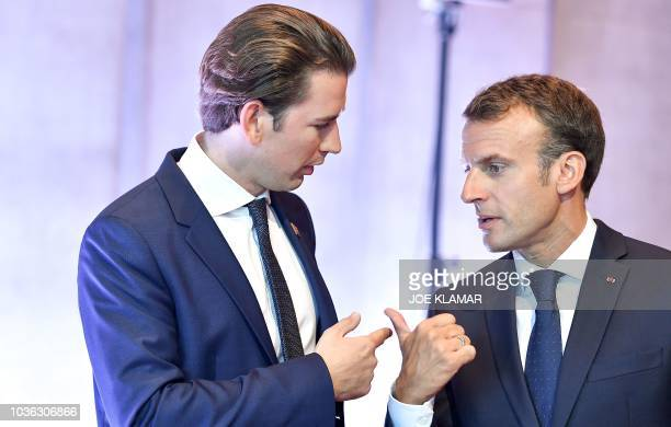 TOPSHOT Austria's Chancellor Sebastian Kurz and France's President Emmanuel Macron confer prior to the start of a plenary session at the Mozarteum...