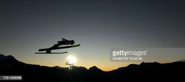 Austria's Chiara Hoelzl soars during the Women Hill Individual training at the jumping hill stadium in Oberstdorf, southern Germany, on March 1...