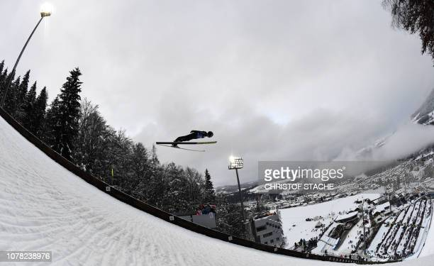 TOPSHOT Austria's Clemens Aigner soars through the air during his training jump at the fourth stage of the FourHills Ski Jumping tournament in...