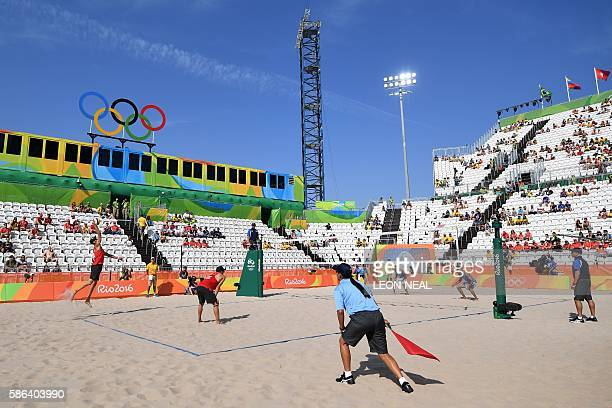 Austria's Clemens Doppler serves the ball during the men's beach volleyball qualifying match between Italy and Austria at the Beach Volley Arena in...