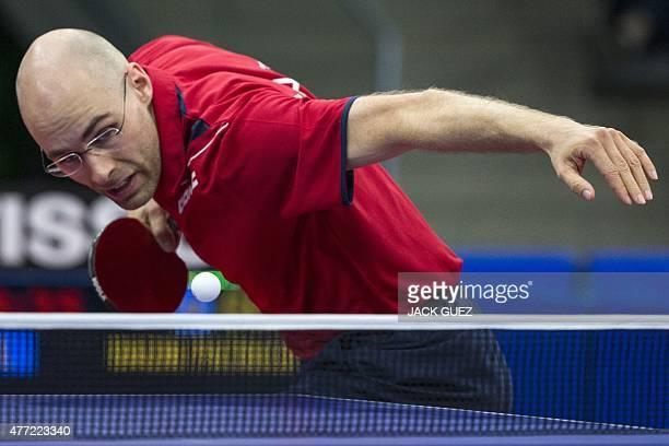 Austria's Daniel Habesohn returns the ball towards Germany's Patrick Baum during the table tennis men's team bronze medal match Germany vs Austria at...
