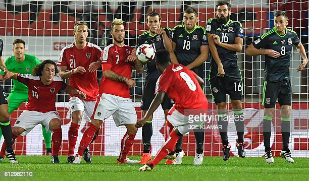 TOPSHOT Austria's David Alaba executes a free kick during the WC 2018  football qualification match between