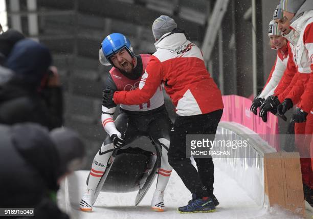 TOPSHOT Austria's David Gleirscher celebrates after competing in the men's luge singles run 4 final during the Pyeongchang 2018 Winter Olympic Games...