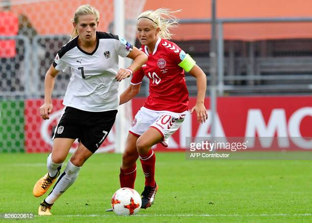 Austria's defender Carina Wenninger vies for the ball with Denmark's forward Pernille Harder during the UEFA Womens Euro 2017 football tournament...