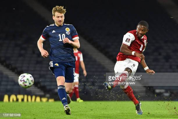 Austria's defender David Alaba has this shot saved during the FIFA World Cup Qatar 2022 qualification football match between Scotland and Austria at...