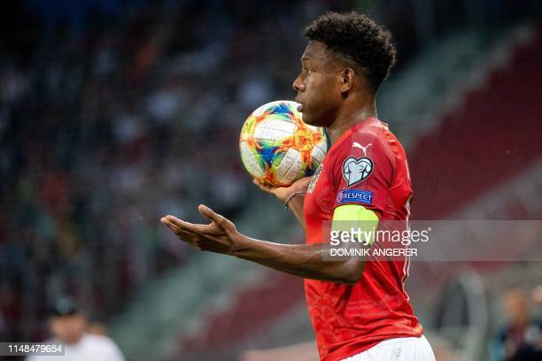 Austria's defender David Alaba holds the ball during the UEFA Euro 2020 qualifier Group G football match Austria against Slovenia on June 7, 2019 in...