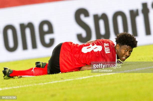Austria's defender David Alaba lies injured on the pitch during the Group D FIFA World Cup 2018 qualification match between Austria and Georgia at...