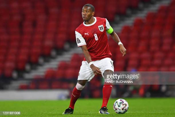 Austria's defender David Alaba looks to play a pass during the FIFA World Cup Qatar 2022 qualification football match between Scotland and Austria at...