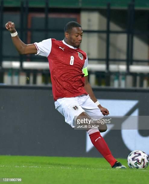Austria's defender David Alaba plays the ball during the FIFA World Cup Qatar 2022 qualification football match Austria vs Faroe Islands in Vienna,...
