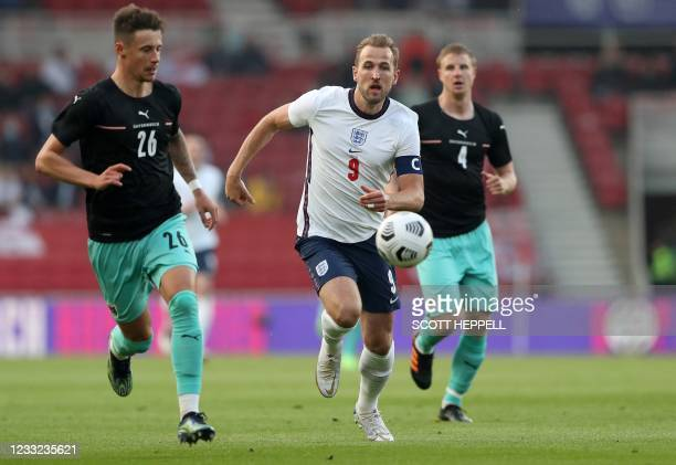 Austria's defender Marco Friedl vies with England's striker Harry Kane during the international friendly football match between England and Austria...