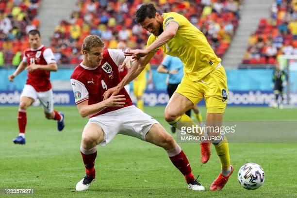 Austria's defender Martin Hinteregger fights for the ball with Ukraine's forward Roman Yaremchuk during the UEFA EURO 2020 Group C football match...