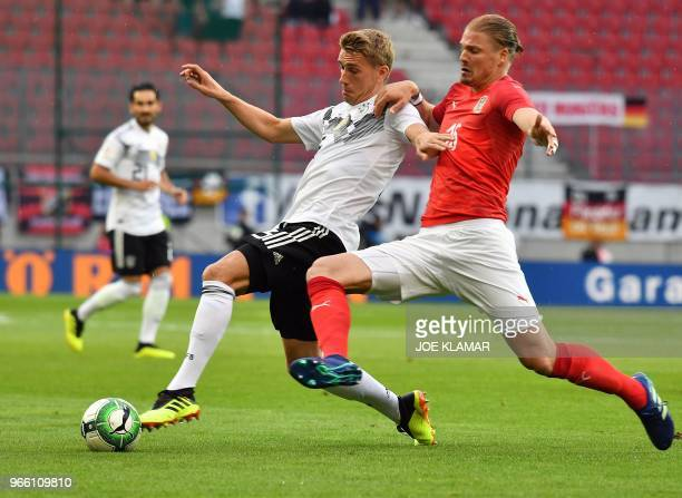 Austria's defender Sebastian Proedl and Germany's forward Nils Petersen vie for the ball during the international friendly footbal match Austria v...