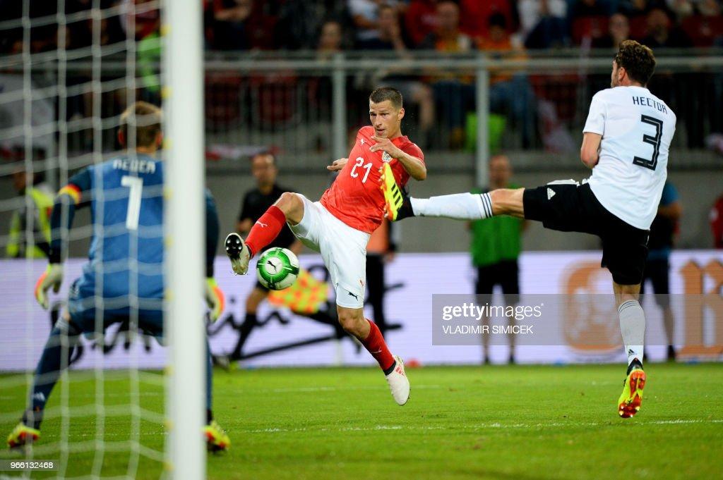 TOPSHOT - Austria's defender Stefan Lainer and Germanys Jonas Germany's defender Jonas Hector vie for the ball during the international friendly footbal match Austria v Germany in Klagenfurt, Austria, on June 2, 2018.