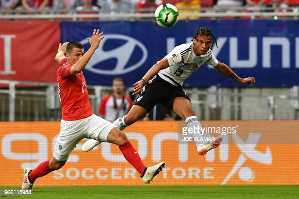 Austria's defender Stefan Lainer and Germany's midfielder Leroy Sane vie for the ball during the international friendly footbal match Austria v...