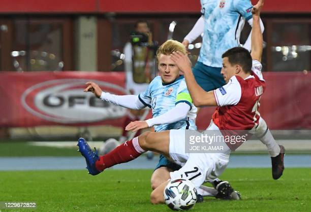 Austria's defender Stefan Lainer and Norway's midfielder Mats Moller Daehli vie for the ball during the UEFA Nations League football match Austria v...