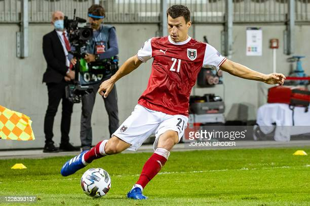 Austria's defender Stefan Lainer kicks the ball during the UEFA Nations League football match between Austria and Romania in Klagenfurt on September...