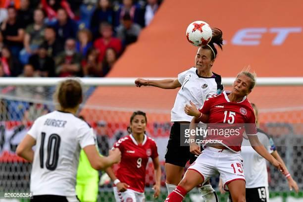 Austria's defender Viktoria Schnaderbeck Austria's goalkeeper Manuela Zinsberger jumps for the ball with Denmark's defender Frederikke Thogersen...