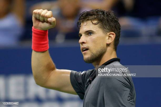 Austria's Dominic Thiem celebrates a point against Spain's Rafael Nadal during their Men's Singles QuarterFinals match at the 2018 US Open at the...