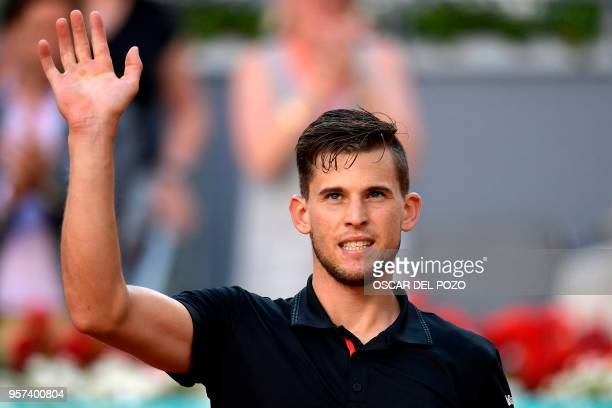 Austria's Dominic Thiem celebrates after beating Spain's Rafael Nadal during their ATP Madrid Open quarter-final tennis match at the Caja Magica in...