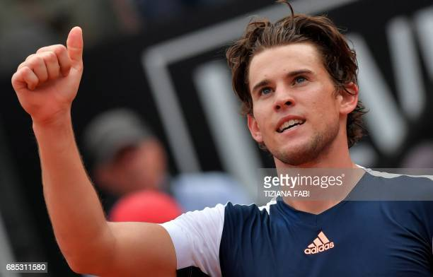 TOPSHOT Austria's Dominic Thiem celebrates after defeating Spain's Rafael Nadal at the ATP Tennis Open tournament on May 19 2017 at the Foro Italico...
